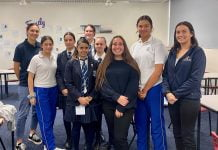 a group of girls from Iona Presentation College smiling at the camera